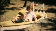 Stock Video Footage of Sisters Enjoy Swinging In Hammock-1968 Vintage 8mm film