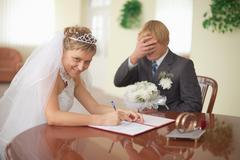 Marriage registration. bride is happy. groom in grief. Stock Photos