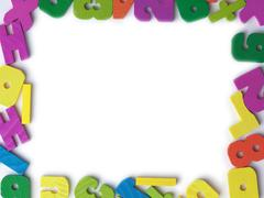 Blank frame of colored wooden toy figures Stock Photos