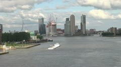 Netherlands Rotterdam skyscrapers behind white barge - stock footage
