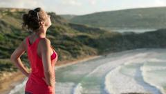 Woman on hike looking at beautiful landscape, crane shot HD - stock footage