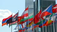 Flags of the different countries against the business center Stock Footage