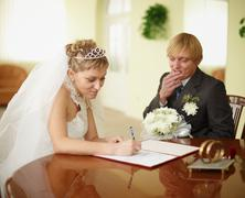 Registration of marriage. groom in doubt. Stock Photos