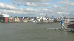 Netherlands Rotterdam blue and white crane and boat sheds Stock Footage