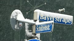 Europe Germany Munich street sign in snowy winter Stock Footage