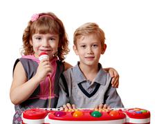 Little girl and boy sing and play music.JPG Stock Photos