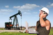 Oil worker with laptop.jpg Stock Photos