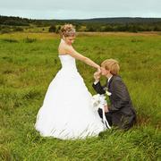 Groom to genuflect near bride Stock Photos