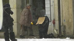 Europe Germany foreigner beggar begging in downtown Munich snowy Winter Stock Footage