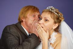 groom tells bride amazing news - stock photo