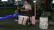 Stock Video Footage of Nightly street performance with cards in Japanese city