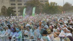 HD Stock Footage 720p- Runners at color run - thousands dancing Stock Footage