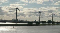 Netherlands Rotterdam three windmills on green strip Stock Footage
