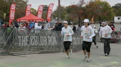 HD Stock Footage 1080p- Runners at color run -  finish line celebration Stock Footage