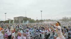 HD Stock Footage 1080p- Runners at color run - Thousands celebrating Stock Footage