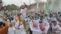 HD Stock Footage 1080p- Runners at color run - thousands celebrate - stock footage