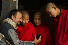 Monks meet Technology - stock photo