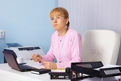 young serious woman - chief in office - stock photo