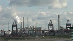 Stock Video Footage of Netherlands Rotterdam refinery passing smoking stack 9