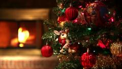 Tracking Across Christmas Tree Revealing Fireplace in Background - stock footage