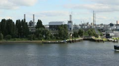 Netherlands Rotterdam boat passes refinery and trees 4 Stock Footage