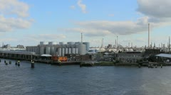 Stock Video Footage of Netherlands Rotterdam passing refinery tubes and stacks 3