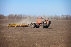 old agricultural tractor sows - stock photo