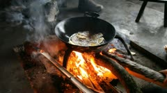 Cooking fried potato in a hut in the village of the minority Yao, Guangxi, China Stock Footage