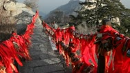 Red ribbons and locks along stair on the way to Sacred Hua Shan mount Stock Footage