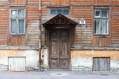 Old door and window of wooden house Stock Photos