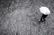Stock Photo of woman with umbrella in rain