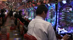 Walking through a pachinko parlor in Japan Stock Footage
