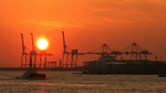 Sunset over the container terminal of Osaka, a major port city in Japan Stock Footage