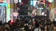 Busy shopping street at night in Osaka in Japan Stock Footage