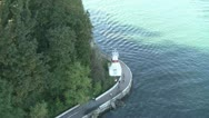 Overhead View Of Lighthouse And Cyclists Stock Footage