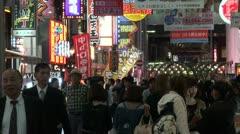 Shopping pachinko parlors people addiction nightlife Osaka Japan Stock Footage