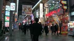 Pachinko parlors in downtown Osaka, addiction, nightlife scene, Japan Stock Footage