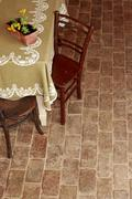 Old table and terracotta tiles Stock Photos