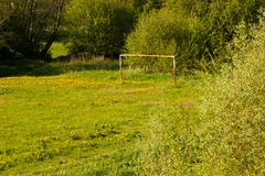 Rural soccer field with white goal posts Stock Photos