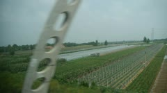 Villages plains tree crops farmland,power plants & transformer stations. - stock footage