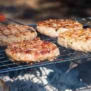 hamburgers on barbeque grill - stock photo