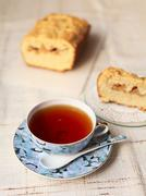 Teacup with cake - stock photo