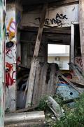 broken asbestos roofing - stock photo