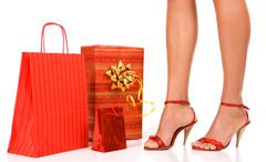attractive woman feet with bags - stock photo