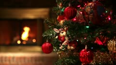 Decorated Christmas Tree with Focus Changing to Fireplace in Background Stock Footage