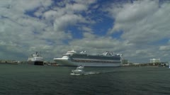 Sailing by port of Fort Lauderdale.  Small boat passing. Cruise ships. Stock Footage