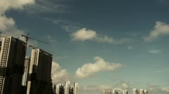 Movement of altocumulus clouds in sky,building high-rise & scaffolding. - stock footage
