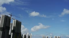Movement of altocumulus clouds in sky,building high-rise & scaffolding. Stock Footage