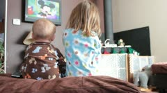 Kids wathcing tv Stock Footage