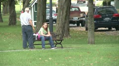 Conversing on a park bench (2 of 4) - stock footage